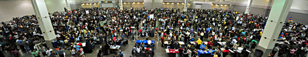 aerial view of college night students talking with college representatives