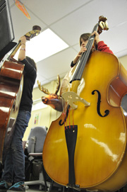 Photo of student with bass