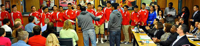 Photo of Tucson High Magnet School boys' soccer team receiving recognition at Board Meeting.