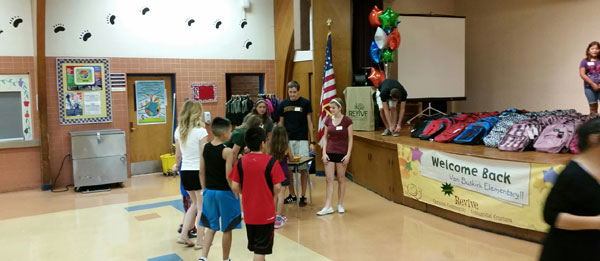 Pantano Christian Church Serving Our Schools Program delivers backpacks filled with school supplies to Van Buskirk students.