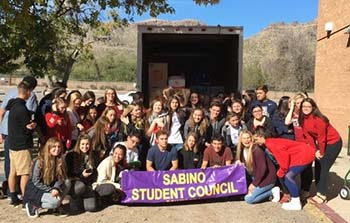 Photo of Sabino students with donations