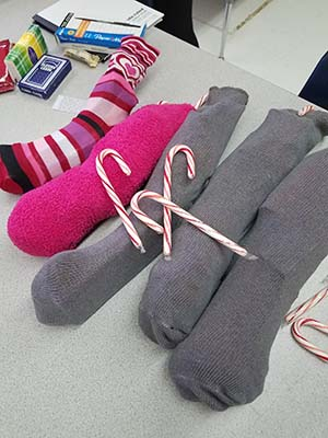 Photo of Staff fixing sock gifts
