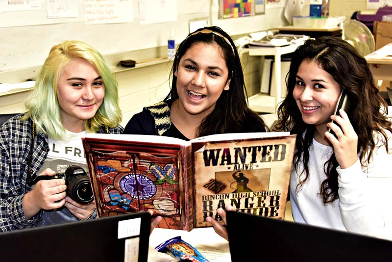photo of Team Rincon Rawhide Yearbook, From left, Guadalupe Burruel, Cheyenne Sevy, Maricruz Pedroza