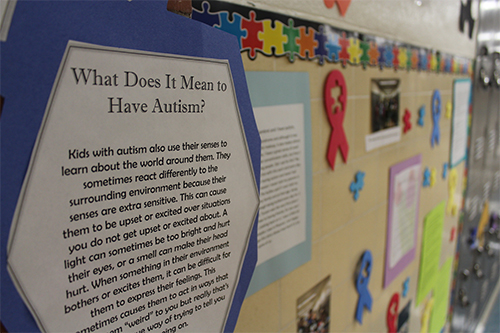 A sign on the wall at Palo Verde explains what it means to have autism