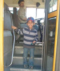 Photo of kindergartener getting on the bus