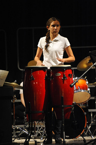 Photo of student playing bongo drums
