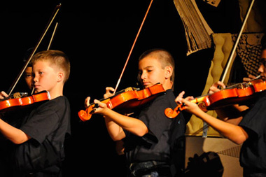 Photo of boys playing violin