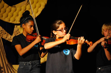 Photo of girls playing violin