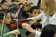 violin teacher with students