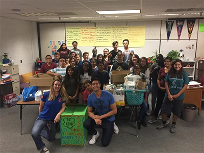 Safford middle schoolers pose with their contributions for hurricane relief.