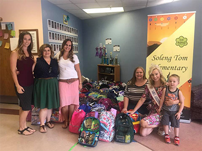 Soleng Tom PTSA and students with donated backpacks