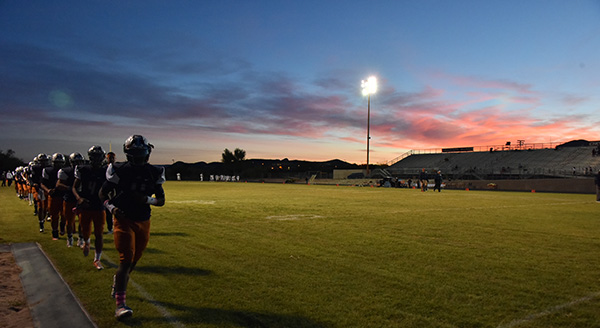 Photo of Cholla football team training at sunset
