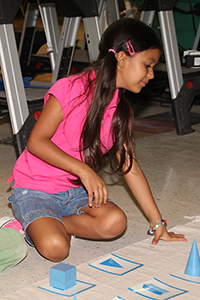 girl playing a game with shapes