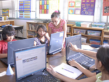 Elementary Students using laptops